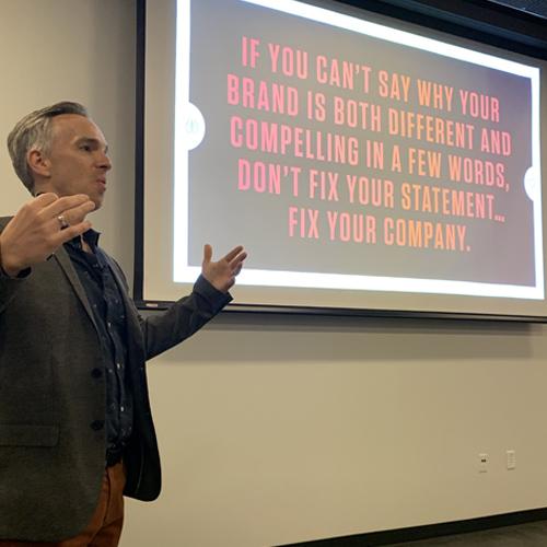 Skot Waldron speaking at a workshop on branding